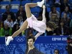 Meagan Duhamel and Eric Radford of Canada compete in the pairs short program figure skating competition.