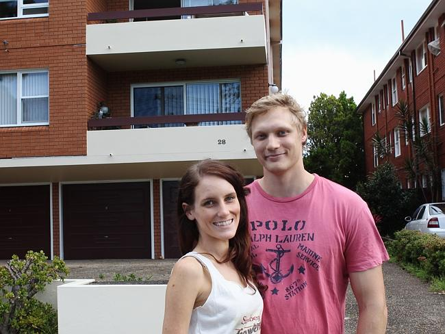 Lauren Ward and James Knight at the front of their apartment block.