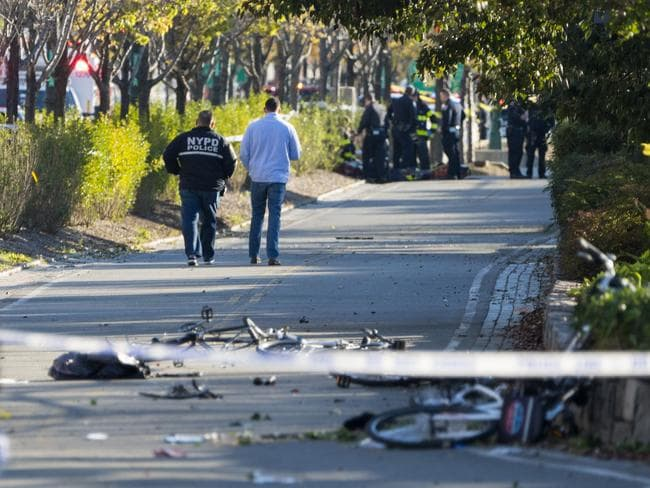 Bicycles and debris lay on a bike path near West and Houston Streets. Picture: AP