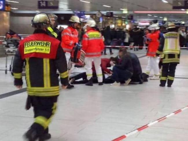Emergency services personnel assist an injured person on the station floor. Picture: Twitter.