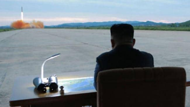 Undated photos released by North Korea show Kim Jong-un during the Hwasong-12 IRBM launch. Picture: KCNA