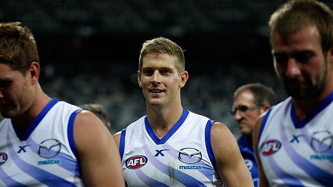Nick Dal Santo and North Melbourne teammates leave the ground pleased with their victory.