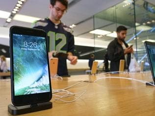 FILE - In this Sept. 16, 2016 file photo, The Apple iPhone 7 is displayed at the Apple Store at the Grove in Los Angeles. Mobile chip maker Qualcomm has filed a breach of contract complaint against Apple's iPhone and iPad manufacturers, the latest in an ongoing dispute.(AP Photo/Richard Vogel)