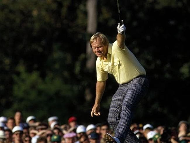 The iconic image of Jack Nicklaus riding his putt to the hole in 1986.