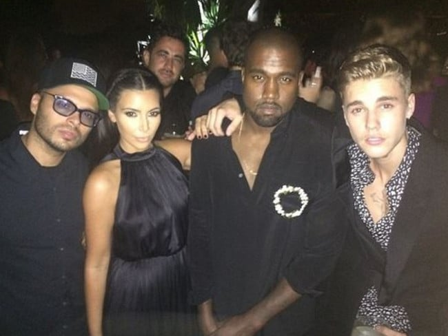 New songs ... West with Kardashian and Justin Bieber in Ibiza earlier this month. Picture: Instagram