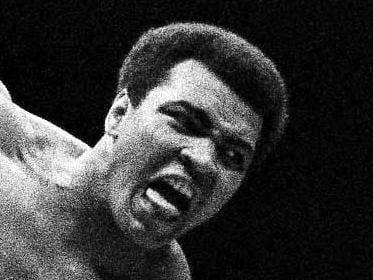 "Japanese pro wrestler Antonio Inoki kicks the back of Muhammad Ali's leg in an attempt to trip him down on the mat during their boxing wrestling bout on June 26, 1976 at the Budokan Hall in Tokyo. Inoki challenged the World Heavyweight boxing champion in a 15-round fight billed as ""World Martial Arts championship."" But the fight ended in a draw before the 14,000 spectators who paid from 17 to 1,000 U.S. dollars for their seat. Ali was to receive 6.1 million dollars and Inoki up to 4 million. (AP Photo/MC)"