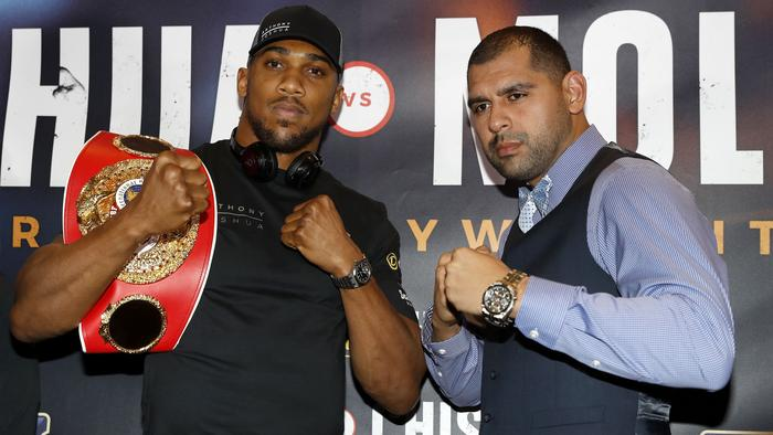 U.S boxer Eric Molina, right, and IBF world heavyweight champion British fighter Anthony Joshua, pose during a press conference in Manchester, England, Thursday Dec. 8, 2016. The championship bout will be held in Manchester on Saturday. (Martin Rickett/PA via AP)
