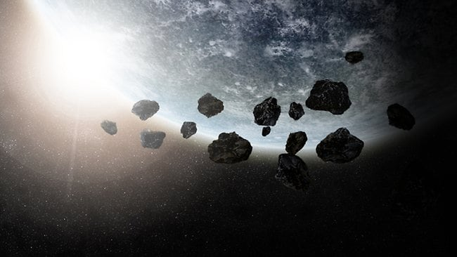 For every asteroid we have located, there are 100 more unseen space rocks orbiting the Sun - and some may be on a path that will bring them past Earth.