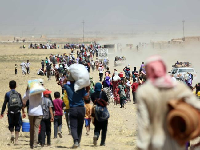 Thousands of Yezidis trapped in the Sinjar mountains as they tried to escape from Islamic State (IS) forces, are rescued by Kurdish Peshmerga forces. Picture: Getty Images