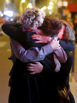 A nation in shock ... People react outside the Bataclan concert hall following the attack.