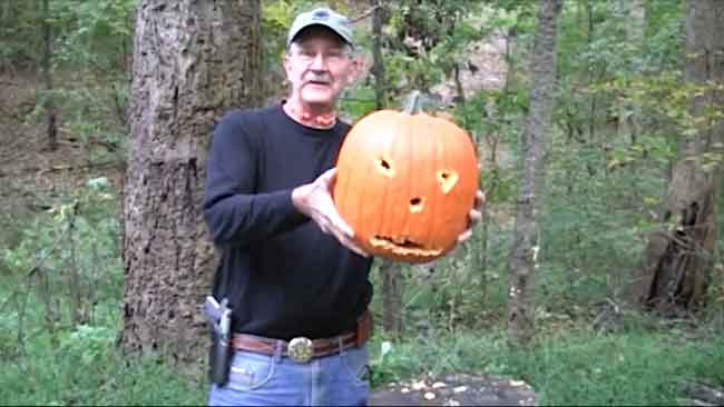 Hickok45 with his gun-carved pumpkin.