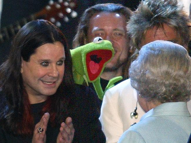 Royal reception ... Queen Elizabeth II is introduced to Ozzy Osbourne and Kermit the Frog on stage during the 'Party at the Palace' pop concert in 2002, as part of her Golden Jubilee celebrations.