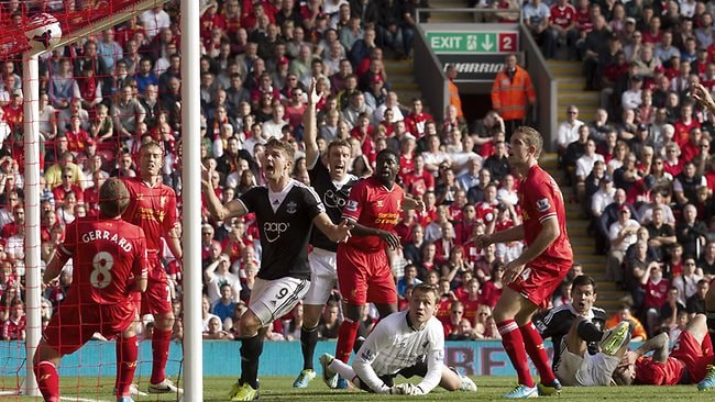 Southampton's Dejan Lovren, bottom right, scores against Liverpool during their English Premier League match at Anfield Stadium.