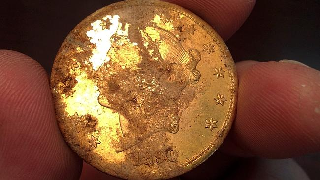 This 19th century gold coin was found by the Californian couple out walking their dog struck Picture: AFP PHOTO/KAGIN'S, INC.