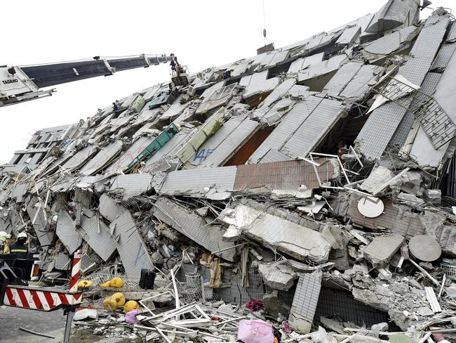 Disaster ... rescuers search for survivors in the collapsed building. Picture: Zhang Guojun/Xinhua/AP