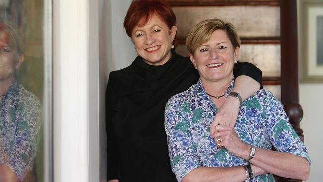 Tony Abbott has said he will attend the wedding of sister Christine Forster (right) and her partner Virginia Edwards Picture: (AAP IMAGE/ Danny Aarons.