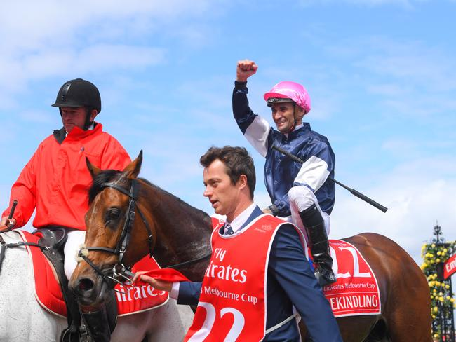 Jockey Corey Brown celebrates after riding Rekindling to Melbourne Cup victory. Picture: Vince Caligiuri/Getty