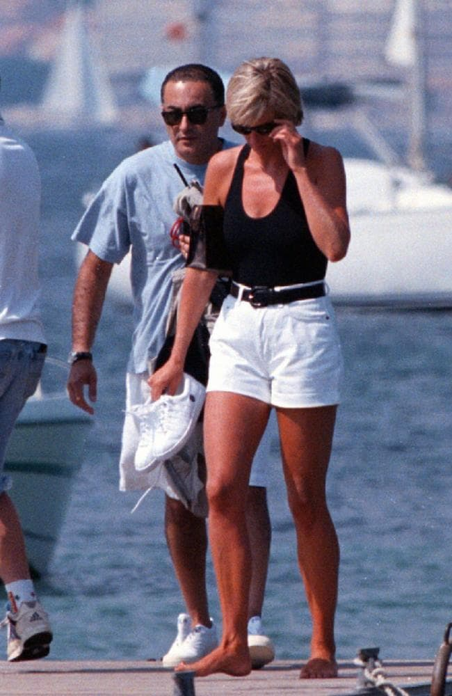 The late Diana, Princess of Wales, right, and Dodi Fayed, walk on a pontoon in the French Riviera resort of St. Tropez in 1997. Picture: AP