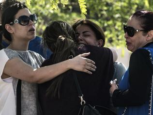 Families of passengers who were flying in an EgyptAir plane that vanished from radar en route from Paris to Cairo react as they wait outside a services hall at Cairo airport on May 19, 2016. The EgyptAir flight that vanished over the Mediterranean was carrying 30 Egyptian and 15 French passengers, as well as a Briton and a Canadian, the airline said. / AFP PHOTO / KHALED DESOUKI