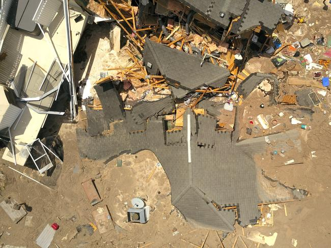 In this aerial photo, the extent of the sinkhole's damage cane be seen. Picture: Luis Santana/Tampa Bay Times via AP