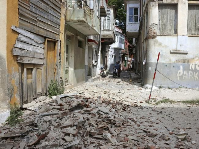 Buildings were damaged in the village of Plomari, on the northeastern Greek island of Lesbos, after an earthquake. Picture: Manolis Lagoutaris/InTime News via AP