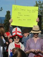 A crowd on Playford Boulevard prepares to greet the Duke and Duchess of Cambridge. Picture: Simon Cross