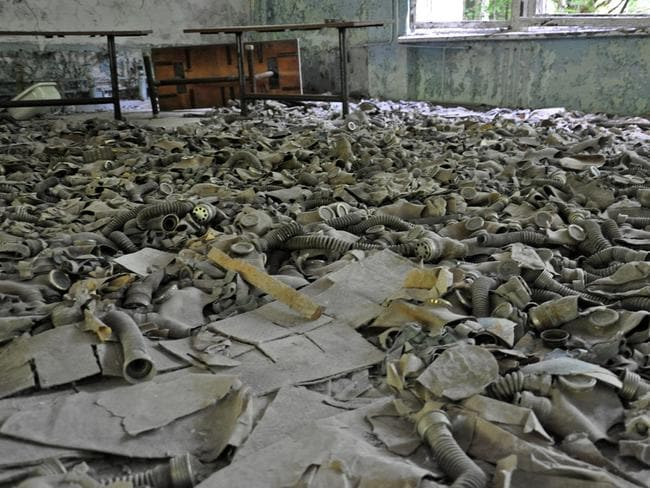 Discarded gas masks litter the floor. Picture: Anosmia.