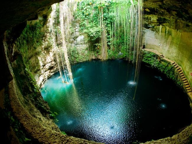 Ik Kil Cenote, Chichen Itza in Mexico. Such natural cave-lakes played a significant role in ancient Mayan culture.