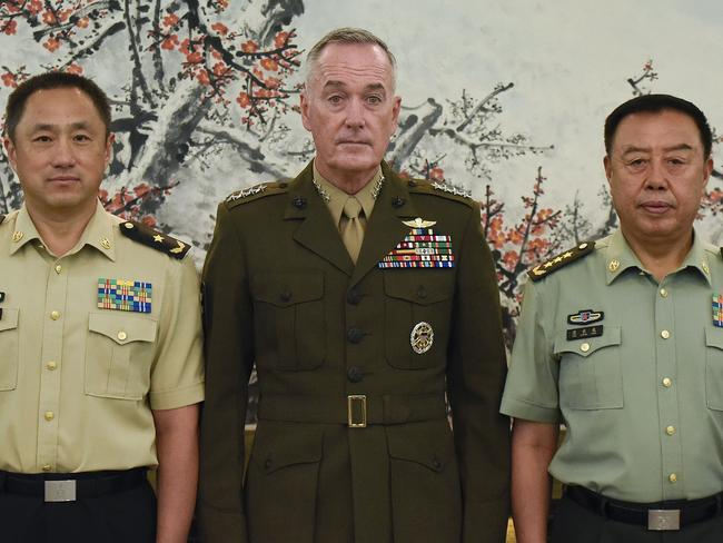 Chairman of the US Joint Chiefs of Staff, General Joseph Dunford (C), poses for a group photo with Chinese vice chairman of the Central Military Commission, Fan Changlong (R), in Beijing. Picture: AFP.