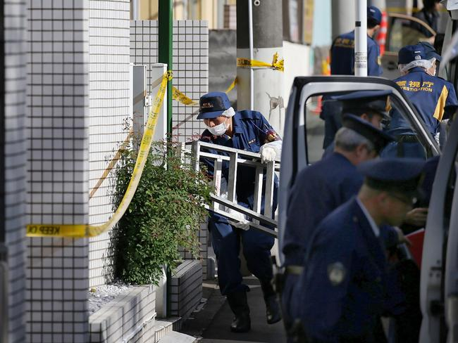 Police outside the serial killer's apartment in suburban Zama in Tokyo, where he killed and cut up nine people. Picture: AFP.