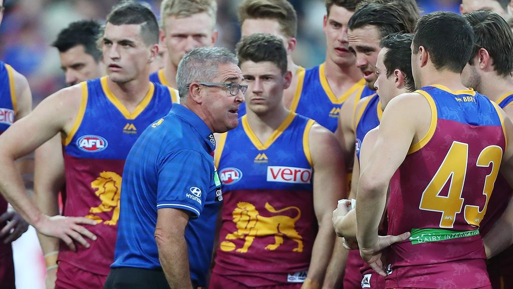 Chris Fagan speaks to his players during the QClash.