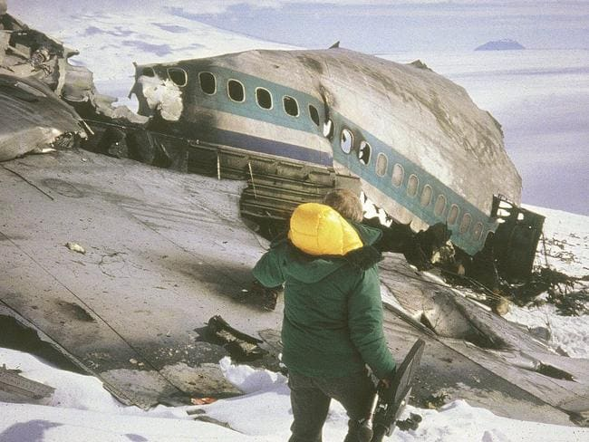 A rescue worker assesses the wreckage of the Air New Zealand DC10 plane after it crashed into Mount Erebus in Antarctica on November 28, 1979. Picture: AP/New Zealand Archives
