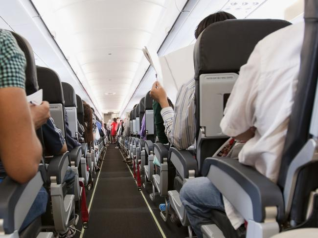 ESCAPE:  Passengers inside the cabin of a commercial airliner during flight. Shallow depth of field with focus on the seats in the foreground.  Picture: Istock