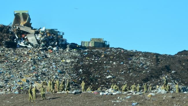 Soldiers get busy looking for some missing military equipment, accidently thrown away.