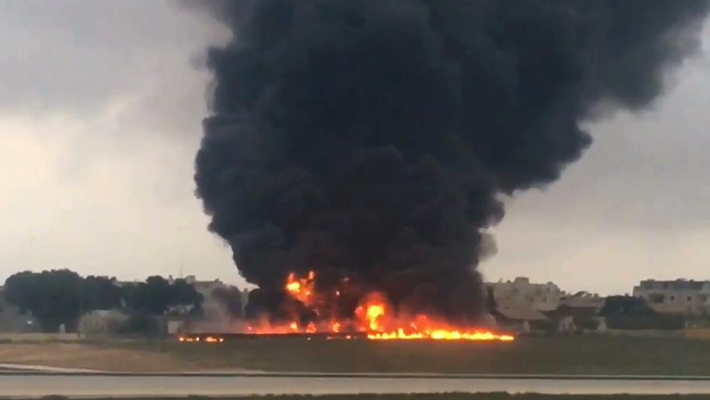 Five people have died after an unmarked plane crashed in Malta. Picture: AP Photo/Ed De Gaetano