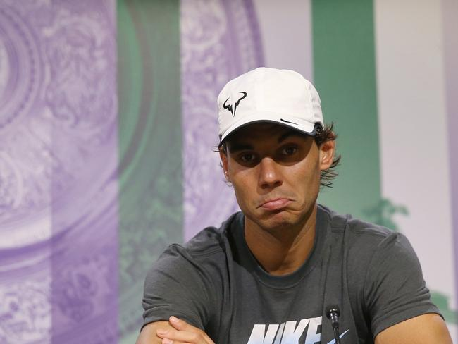 Rafael Nadal attends a press conference after being defeated by Nick Kyrgios.