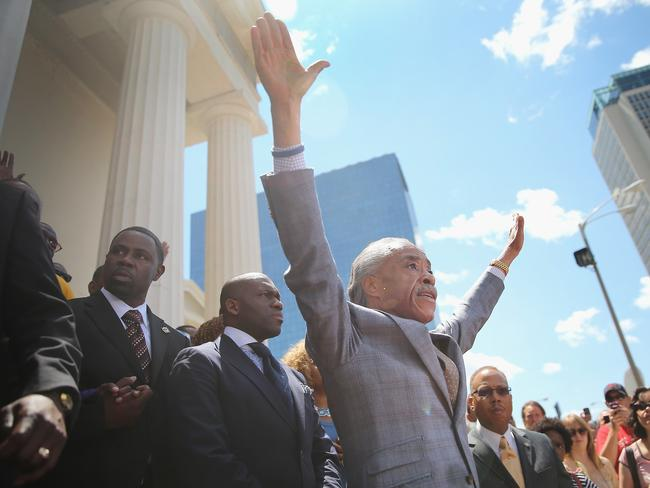 Appeal for calm, and justice ... Civil rights leader Reverend Al Sharpton and Brown's family were calling for order following riots and skirmishes with police in recent nights. Source: AFP