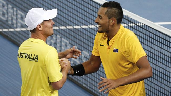 Kyrgios celebrates his win over John Isner with Lleyton Hewitt.