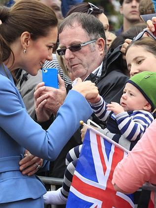 Catherine, the Duchess of Cambridge, entertains nine-month-old Alton King whilst on a walkabout in Seymour Square during a visit to the New Zealand. Picture: AFP