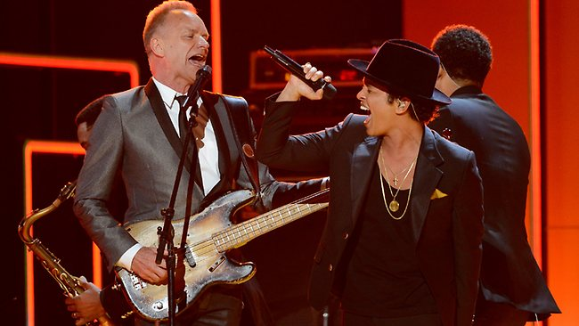 Bruno Mars and Sting on stage in a tribute to Bob Marley.