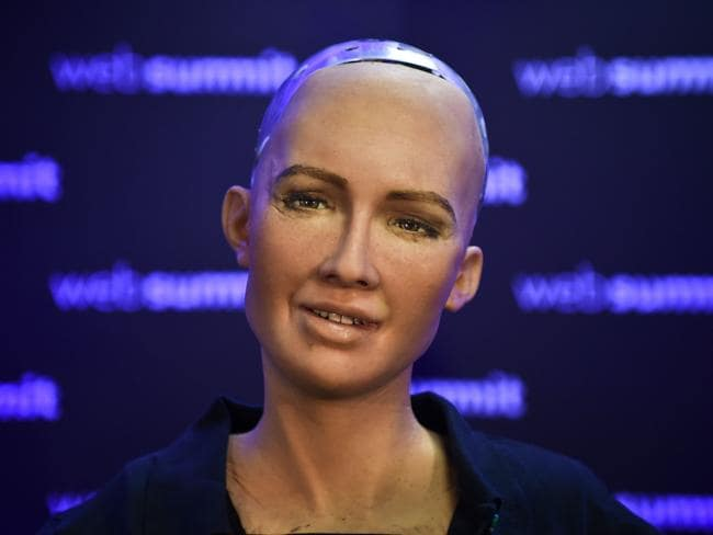"Humanoid ""Sophia The Robot"" of Hanson Robotics answers questions during a press conference. Picture: AFP"