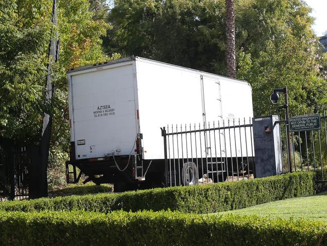 Moving vans are pictured at Angelina Jolie and Brad Pitt's Hollywood compound. Picture: Mark Kreusch/Splash News