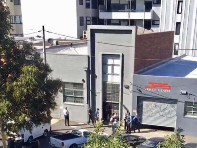 Exclusive pictures of Police raiding a Rouse Street, Port Melbourne property owned by Mark Bomber Thompson.