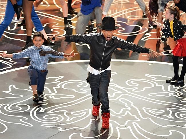 Singer Pharrell Williams performs onstage during the Oscars.