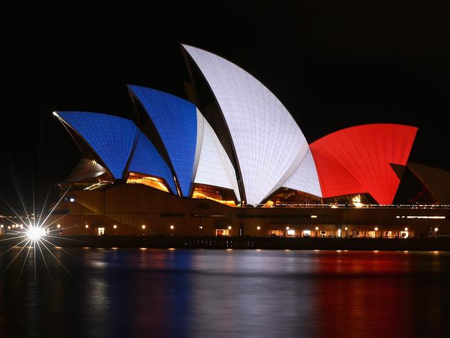 Spectacular ... The sails of the Sydney Opera House are illuminated in the colours of the French flag. Picture: Getty