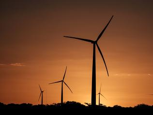 Wind turbines are seen at Vamcruz Windfarm, developed by three energy companies including French renewable energy power plants operator Voltalia Group, on June 29, 2016, in Serra do Mel, Rio Grande do Norte State, Brazil. Vamcruz Windfarm Complex was inaugurated with 31 wind turbines, which have the potential to supply 200,000 families with energy. / AFP PHOTO / YASUYOSHI CHIBA