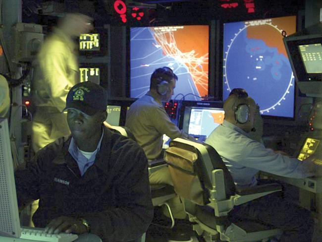 An Aegis destroyer operations room - all the computers and displays etc make up the combat system that would guide a missile interception is here. Picture: US Navy