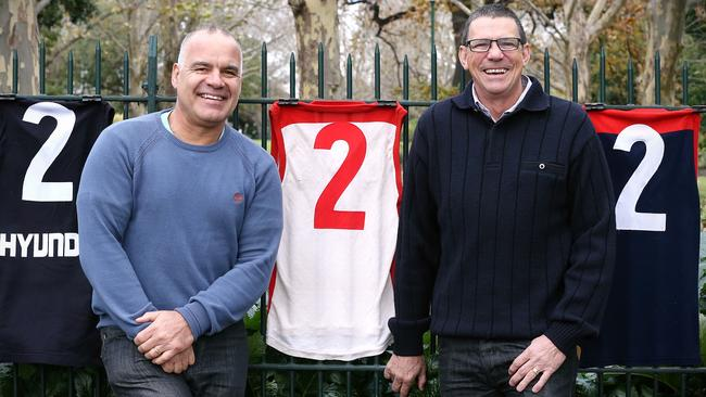 Greg Williams and Robbie Flower with their famous No. 2 jumpers. Picture: Wayne Ludbey