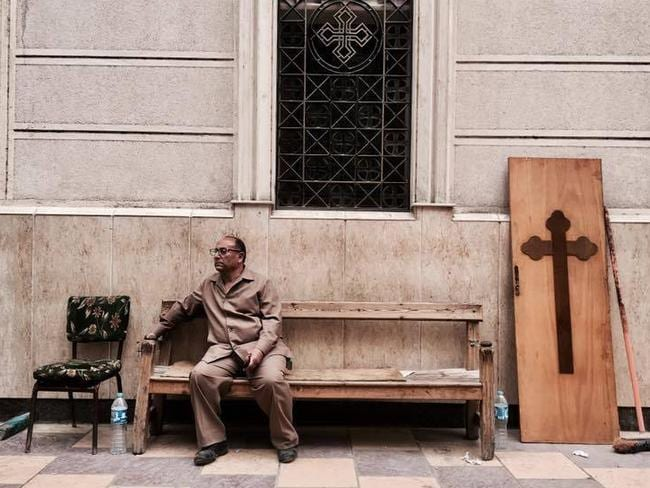 A man sits on a bench outside a church after a bomb attack in the Nile Delta town of Tanta, Egypt. Picture: AP/Nariman El-Mofty