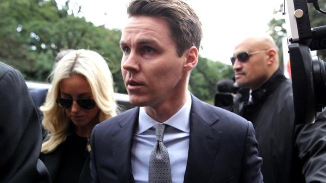 Oliver Curtis and wife Roxy Jacenko ahead of his sentencing on Friday.